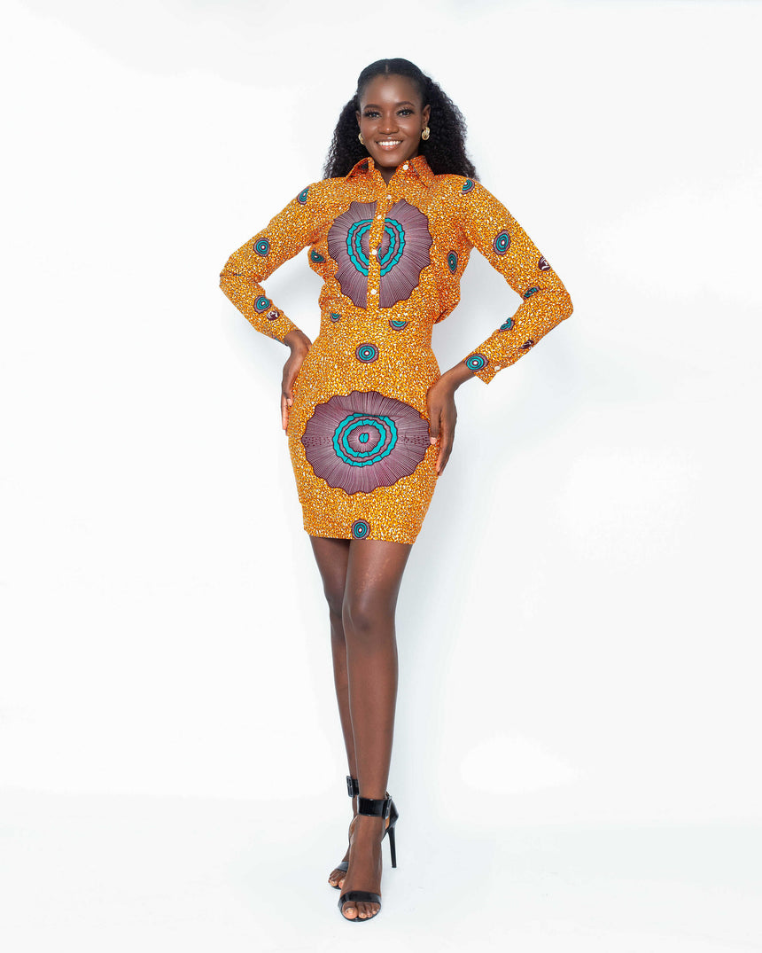 Camera Ready Shirt and Mini Skirt Set is a A long sleeve shirt and mini skirt set with a tiny side slit made with elaborate matching patterns Ankara fabric  by jvkclothing
