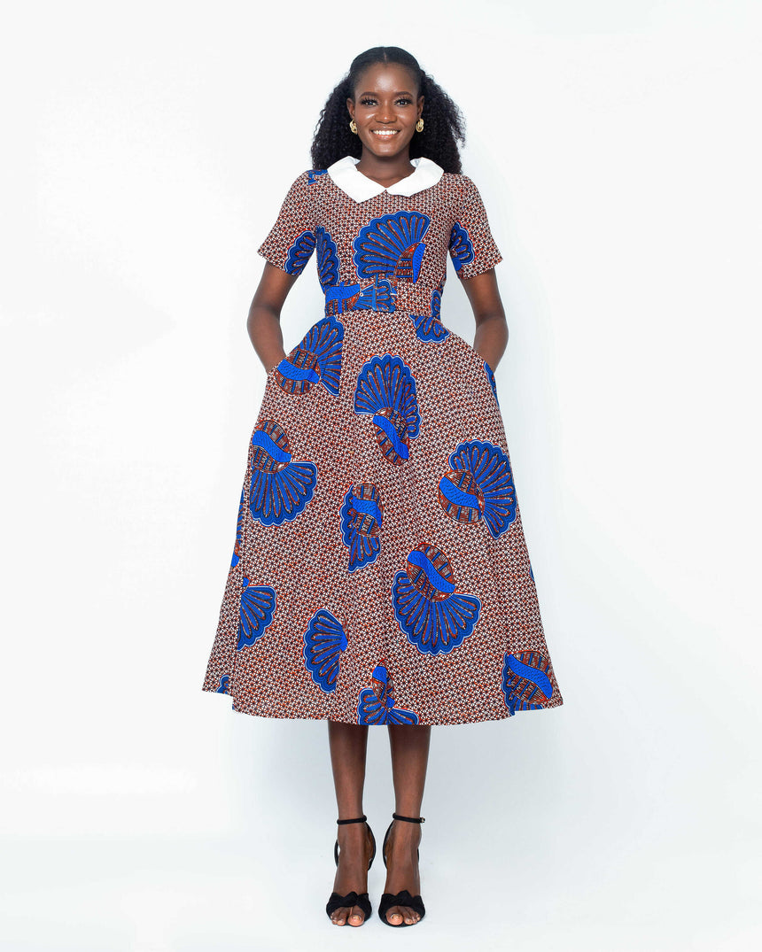 Totally Victoria Midi Dress is A belted baby doll midi dress with a contrasting white collar and fitted bust made with Ankara fabric by jvkclothing