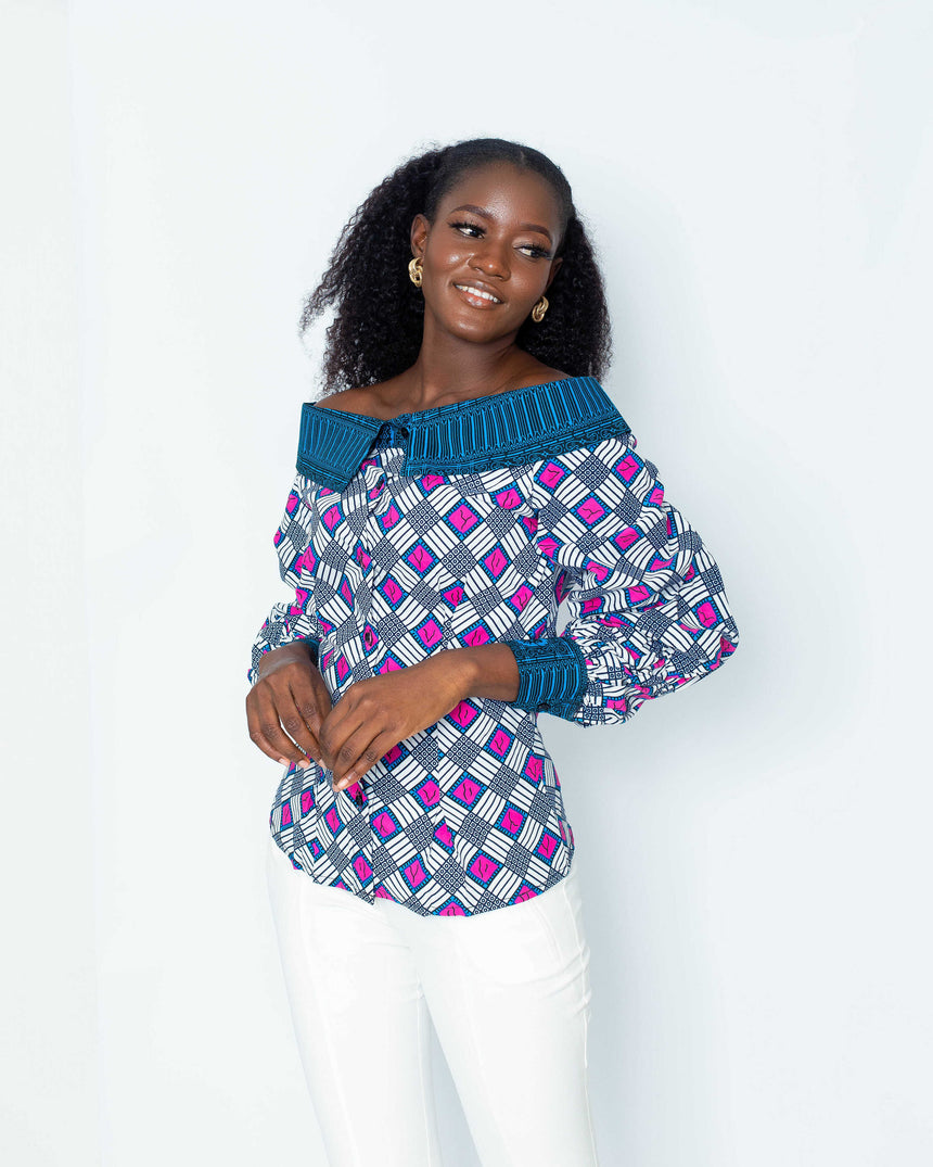Lucky Dip Offshoulder Top is A two-tone fitted off-shoulder blouse with elasticated balloon sleeves made with Ankara fabric by jvkclothing