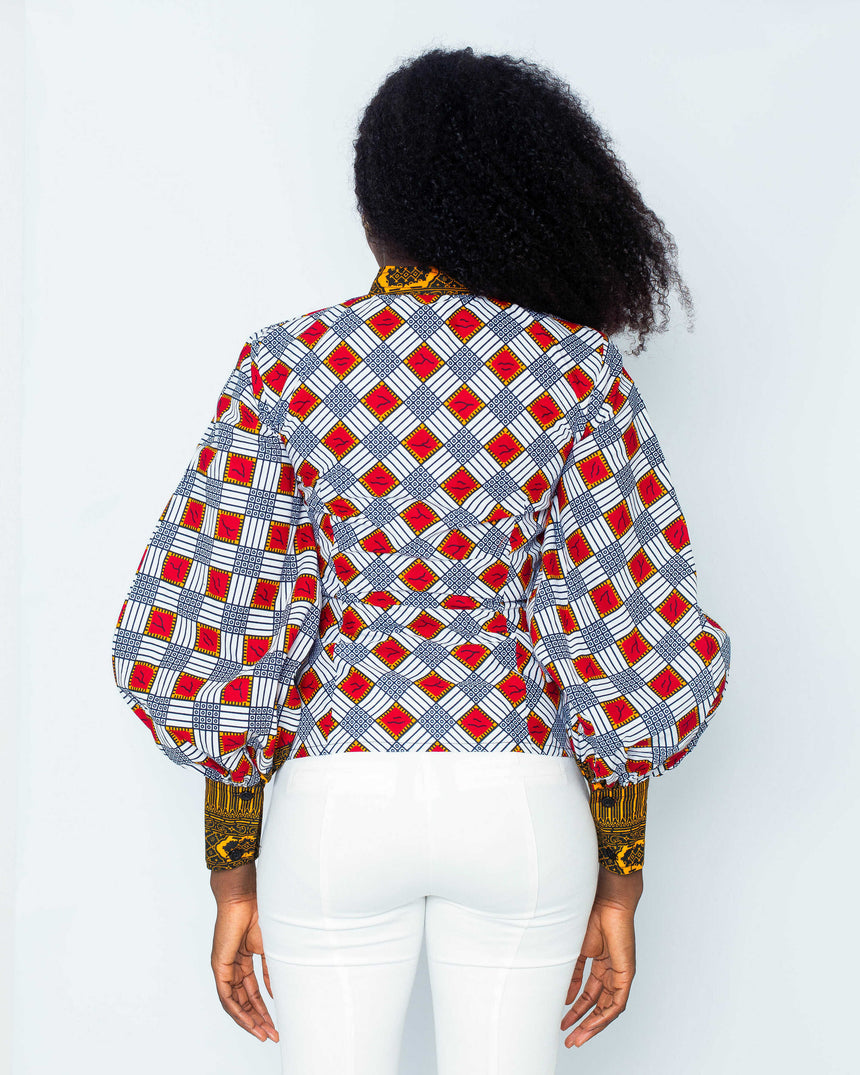 Selfie Addict Top is a two toned fitted bell sleeve ankara shirt with an attached bow by jvkclothing