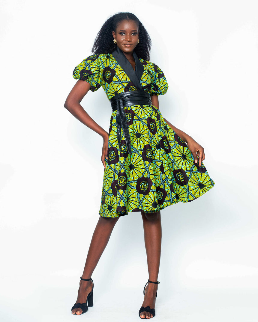 Chica Bonita Wrap Dress is a midi ankara wrap dress with puff sleeves and a contrasting black satin collar by JVK Clothing