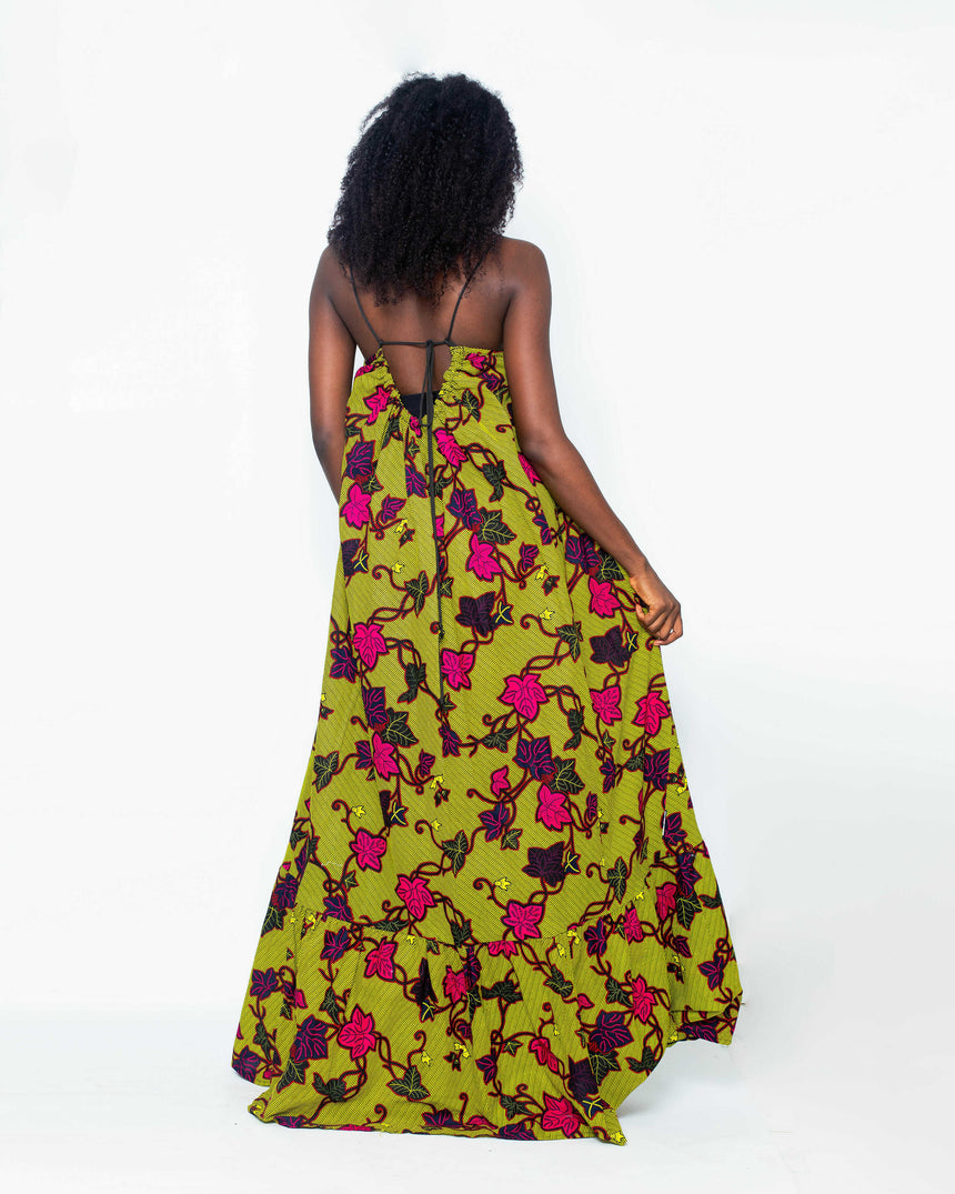 Pleasure Seeker Maxi Dress is A bright free flowing maxi Ankara sundress with stylish thin black sleeves that converge at the back to create a pretty bow by JVK Clothing
