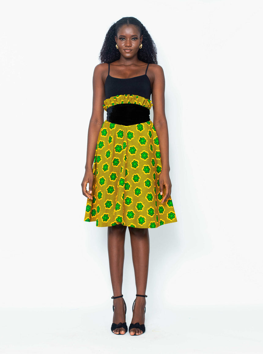 Smashed Midi Flair Skirt is A midi length flair Ankara skirt with a bold velvet contrast and mini pleats at the top by JVK Clothing