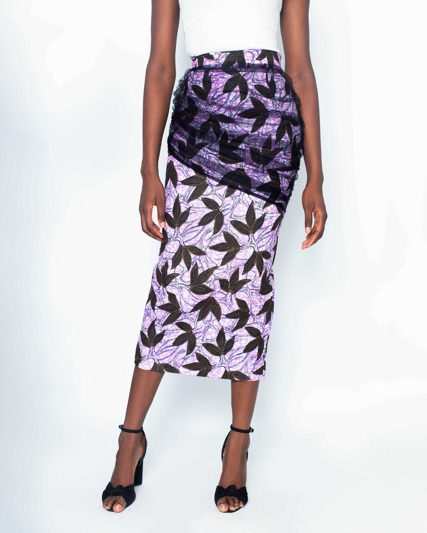 Life of the Party Midi Pencil Skirt is A figure hugging midi length pencil ankara skirt with sheer net ruffles joined at the hips made by JVK Clothing