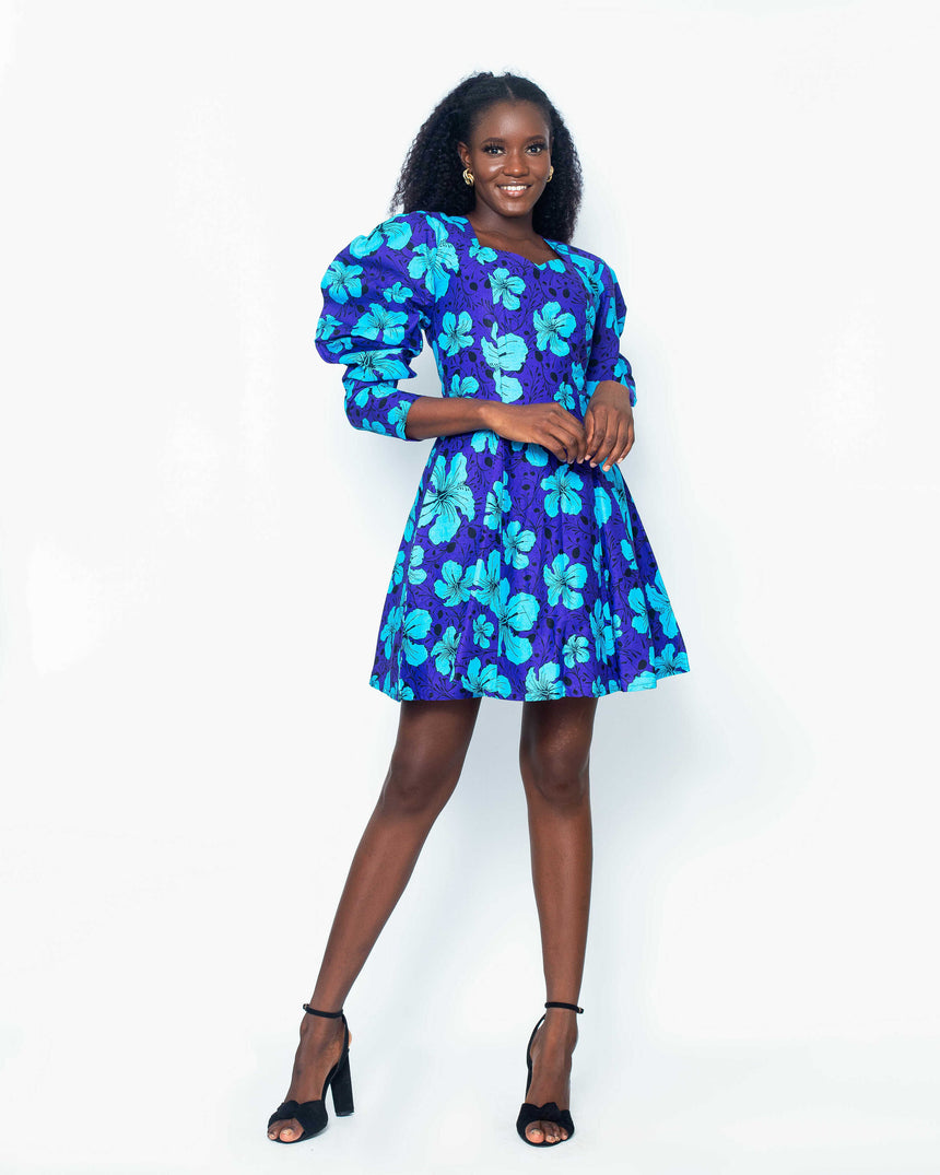 Enchantress Flair Mini Dress is A mini flair Ankara dress with bold balloon sleeves and a sweetheart neckline in pretty hues of blue  by JVK Clothing