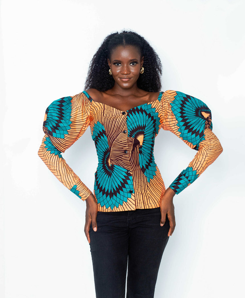 Fair Enough Fitted Top is a A fitted ankara top with elaborate puffy long sleeves  by JVK Clothing