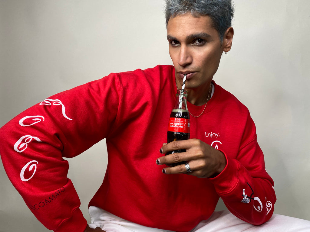 unisex coco-cola red crew neck sweatshirt with white logo graphics on arms and front left chest