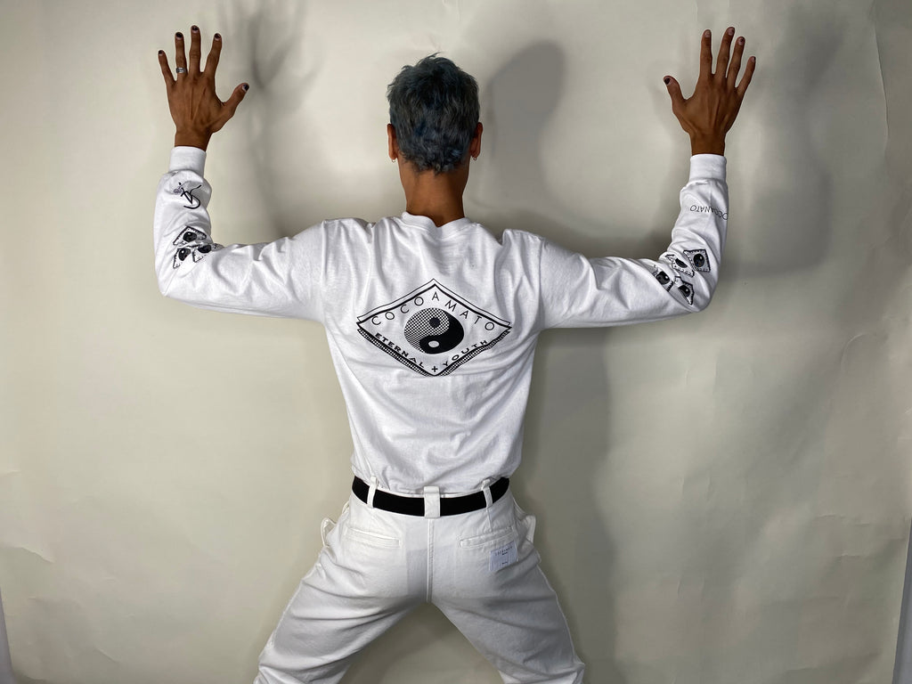unisex white long sleeve t-shirt with yin yang graphics on sleeves, front pocket, and back