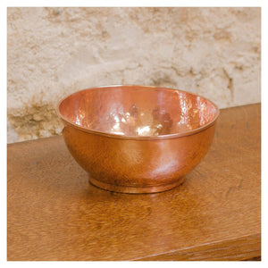 An Arts & Crafts Lakes School hand beaten copper bowl by Fanny Carter