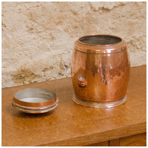 An Arts & Crafts Lakes School hand beaten copper jar by Fanny Carter