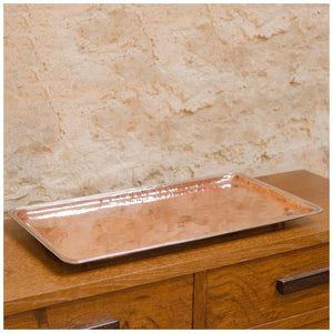 An Arts & Crafts Lakes School hand beaten copper tray by Fanny Carter