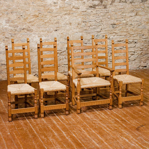A set of 8 Rupert Griffiths Arts & Crafts English Oak Rush Seated Dining Chairs