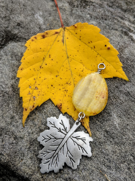 Yellow Jade drop and pewter leaf on bright yellow leaf