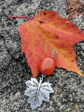 Load image into Gallery viewer, Orange quartzite nugget and pewter leaf on fiery orange leaf