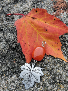 Orange quartzite nugget and pewter leaf on fiery orange leaf
