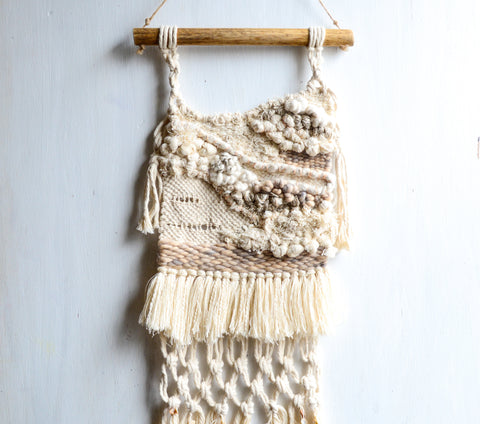 Handwoven  neutral wall hanging with macramé detail