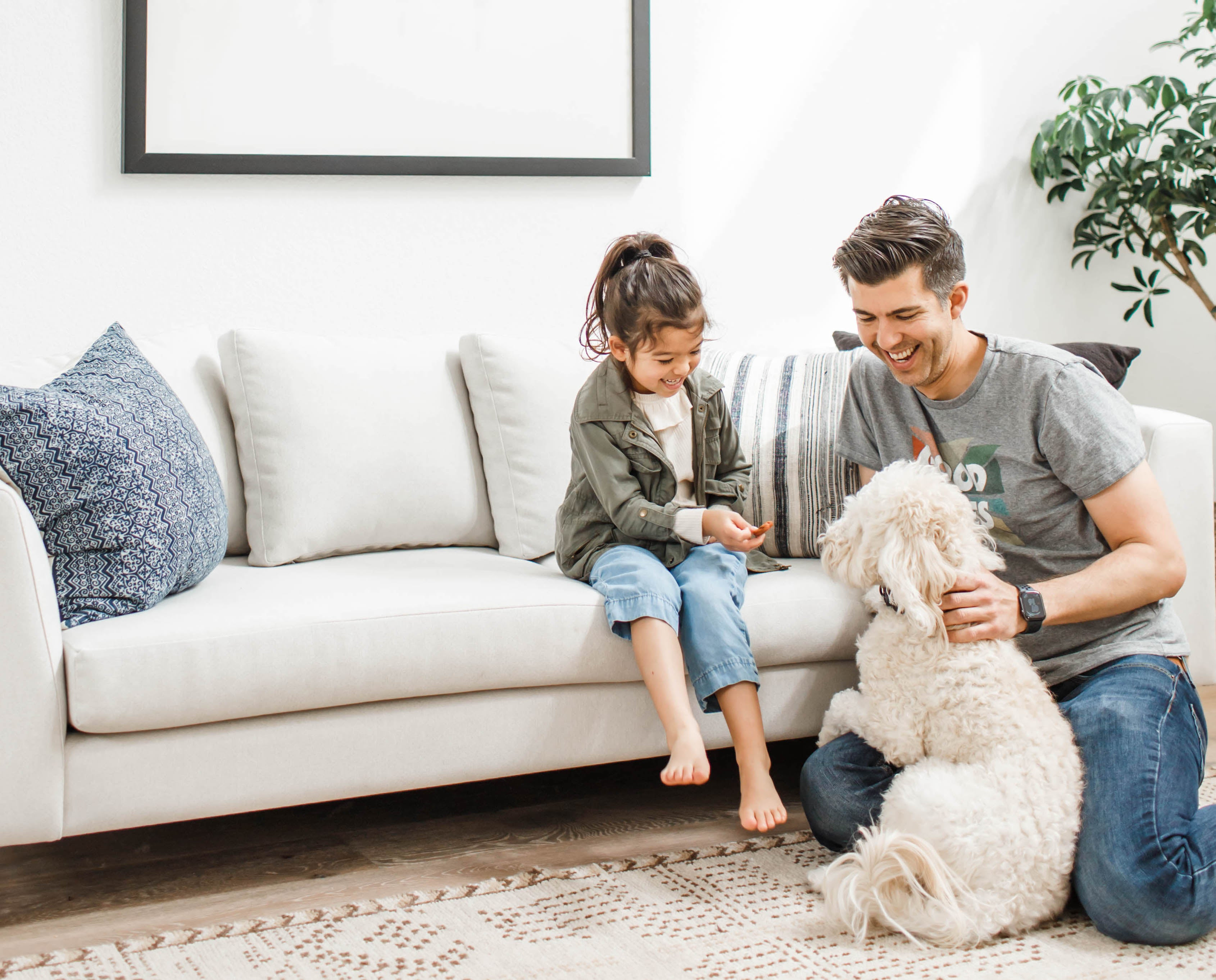 Father, daughter, and dog on Dekayess Sofa