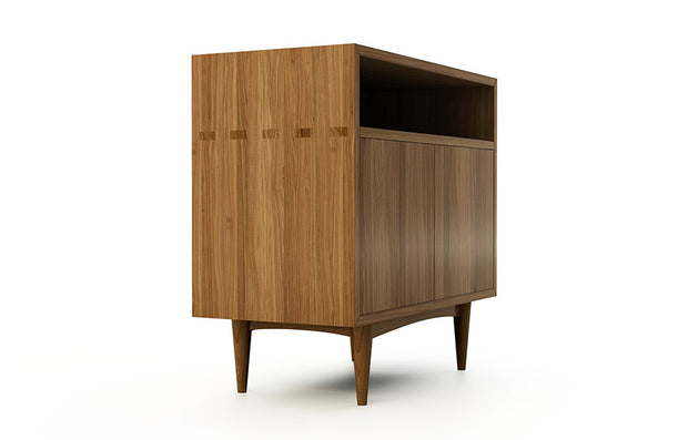 Showing side view of open self 2 door credenza in walnut finish.