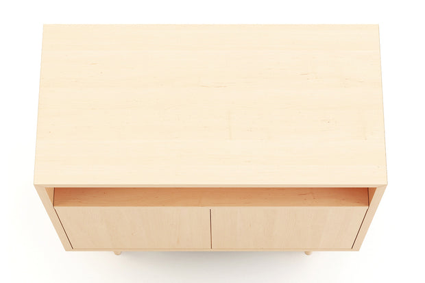 Showing top view of open self 2 door credenza in maple finish.