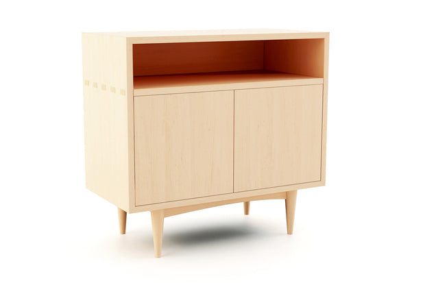 Showing angle view of open self 2 door credenza in maple finish.