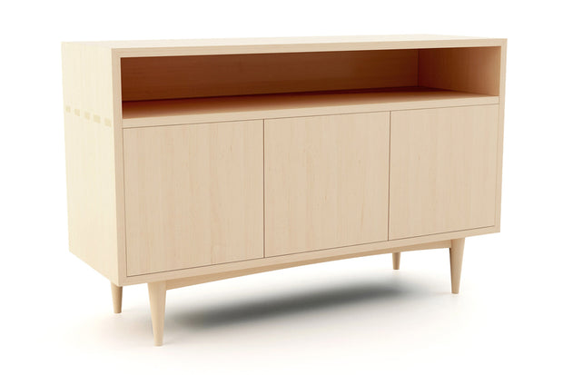 Showing angle view of open shelf 3-door credenza in maple finish.