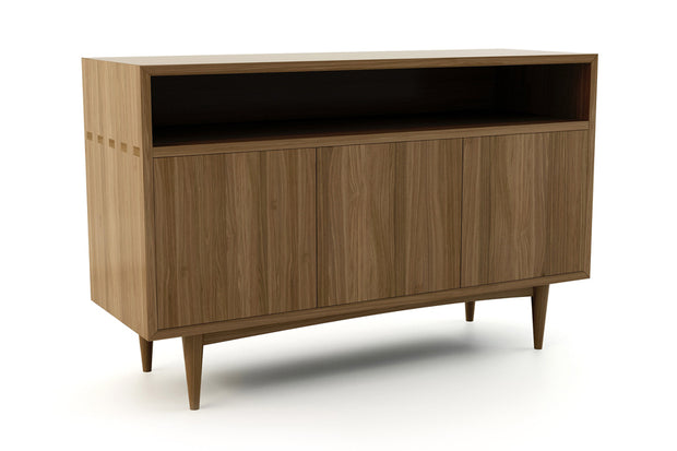 Showing angle view of open shelf 3-door credenza in walnut finish.