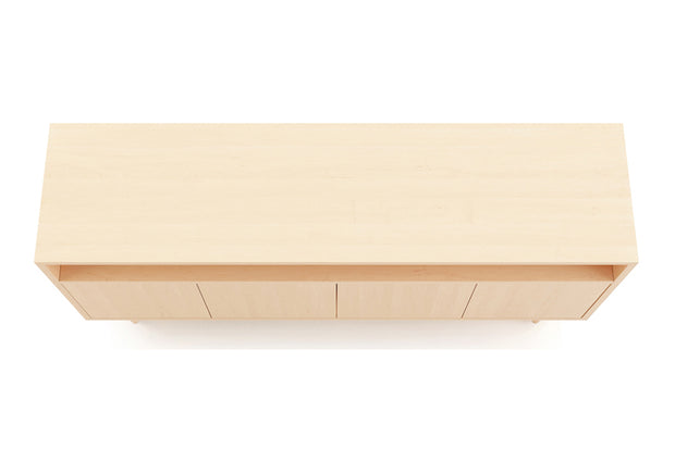 Showing top view of open shelf 4-door credenza in maple finish.