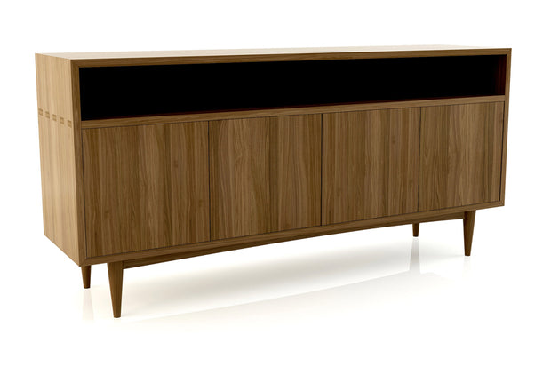 Showing angle view of open shelf 4-door credenza in walnut finish.