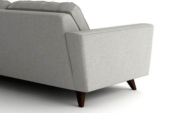 The back is angled which gives the piece a lighter look and unique perspective. Works well when the back is open to the room. (Pel sofa shown)