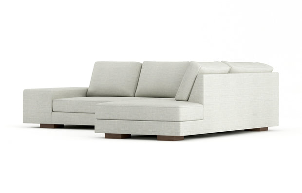 Showing angle view of the right bumper sectional in cafe legs.