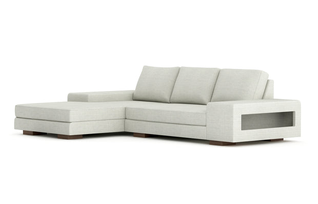 Showing angle view of the left chaise sectional in cafe legs.