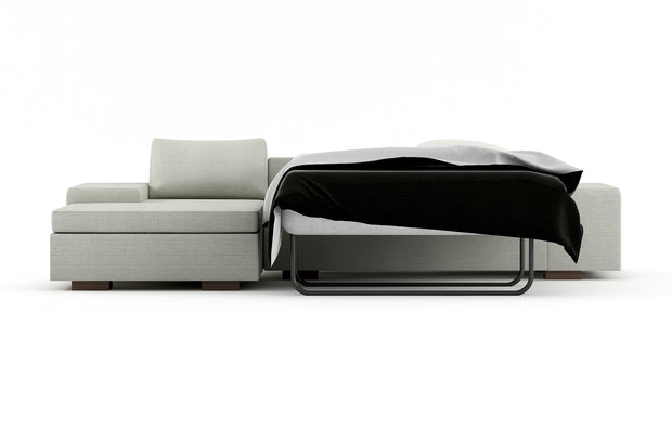 Showing front view of the left chaise full sleeper sectional in cafe legs.