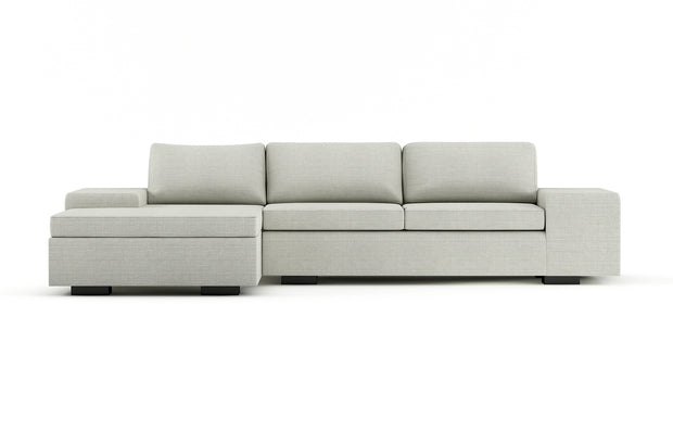 Showing front view of the left chaise full sleeper sectional in black legs.
