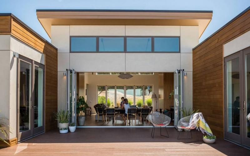 Blu Homes Breezehouse boasts a large living area with access to the outdoors.