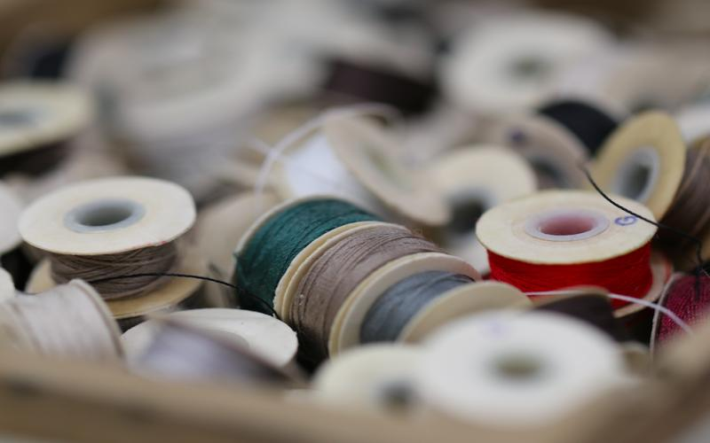 Close-up view of spool of colored threads for stitching.