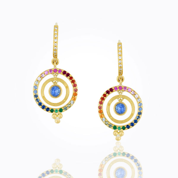A pair of earrings by Temple St. Clair Santa Fe Jewelry that display a center sapphire.