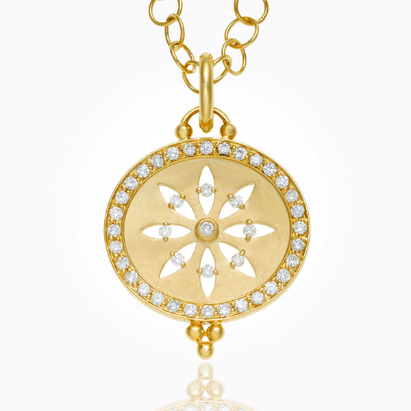 This is a sorcerer cutout pendant similar to a snowflake made by Temple St. Clair Santa Fe Jewelry