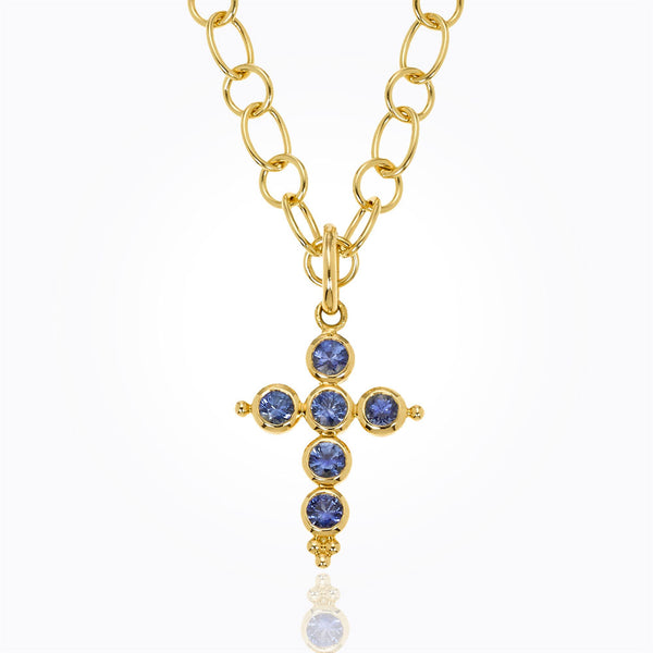 A classic cross pendant with sapphires made by Temple St. Clair