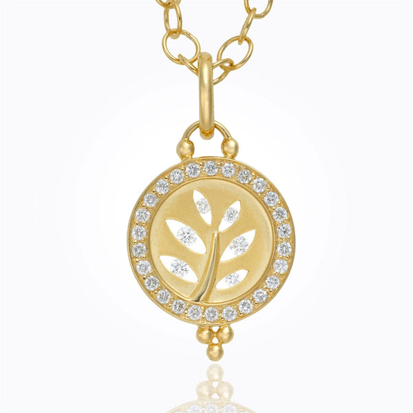 A front shot of a tree cutout pendant by Temple St. Clair Santa Fe Jewelry