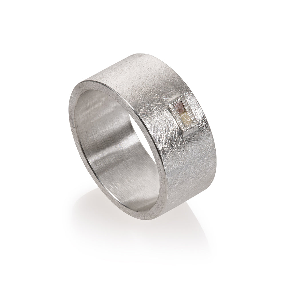 A Todd Reed Silver ring with a diamond in the top middle Santa Fe Jewelry.