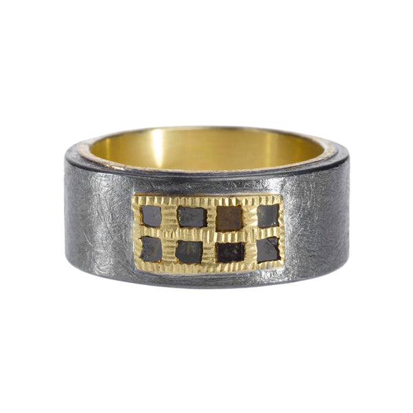 A Todd Reed ring with a grid looking gold cover.