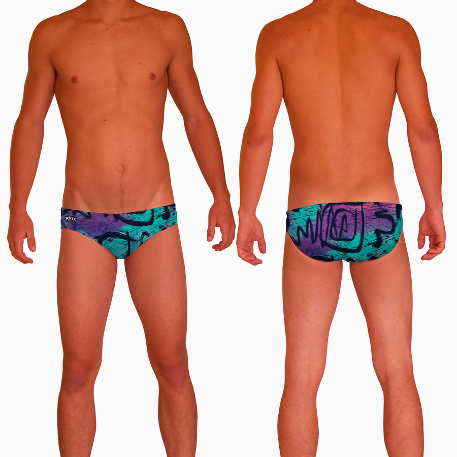 1989 Graffiti Mens Water Polo Suit  Features:  Compression Fitting PBT/Polyester Blend Fabric with Four-way stretch technology Dual Layer Lined Brief Low Stretch Flat Drawcord Flatlock Stitch Construction prevents chafe Turned In Liner Seams for Optimum Comfort Chlorine Resistant Fabric