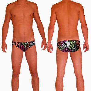 1987 Skulls Mens Water Polo Suit  Features:  Compression Fitting PBT/Polyester Blend Fabric with Four-way stretch technology Dual Layer Lined Brief Low Stretch Flat Drawcord Flatlock Stitch Construction prevents chafe Turned In Liner Seams for Optimum Comfort Chlorine Resistant Fabric