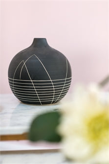 These beautiful black handcrafted vases are wonderful for any shelf alone, but are really incredible paired together.   We love the subltle designs on the sides of each one of them.  Gorgeous on any bar or shelf.   Budvase 4.25 x 4  Vase 7 x 7