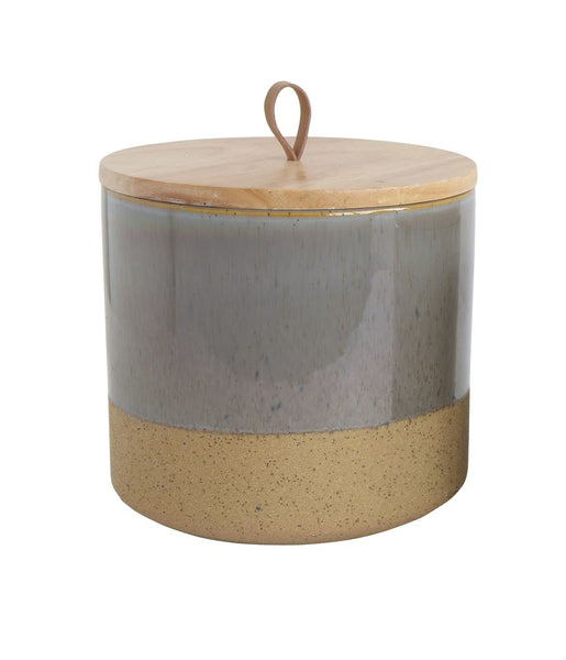 This is a favorite for shelving decor.  A must have to add different textures to your shelves. A real wood top with leather loop, grey speckled jar and a sandy tone on the bottom.