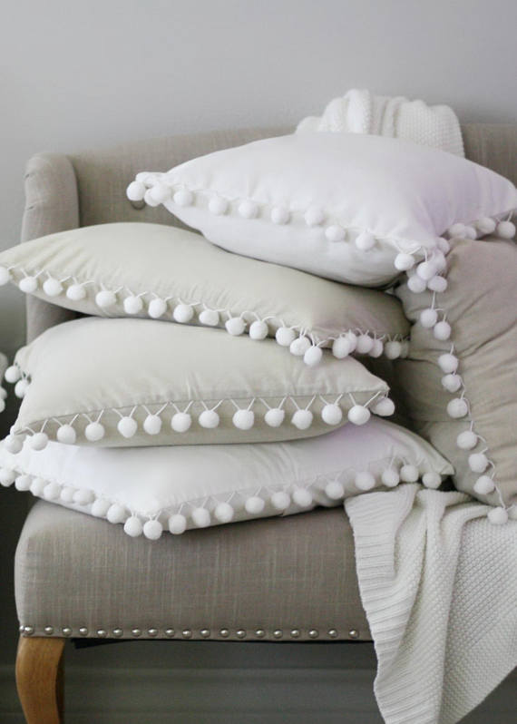 These Pom Pom Pillows are the cutest!  It comes in 2 colors, white and nude.  The fabric is made using a thick cotton and the backing is 100% cotton duck cloth in solid white. This pillow case has a hidden zipper style closure. For best results we recommend dry cleaning only.  20 x 20 - Premium Down Insert Included
