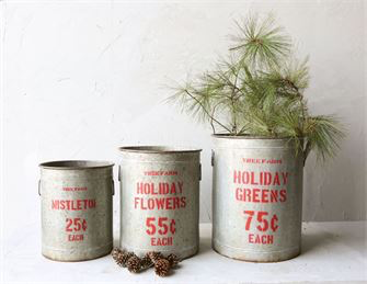 "Oversized Holiday Greens Metal Buckets: 3 sizes   Perfect for the cutest porch on the block! Also amazing for a fire place.  Small Mistletoe:14-1/4"" Round x 17""H  Medium Holiday Flowers: 16-1/2"" Round x 20-1/4""H  Large Holiday Greens 18-1/4"" Round x 22-3/4""H"