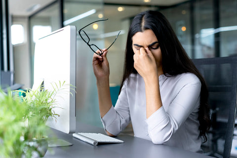 Woman with tired eyes from using the computer