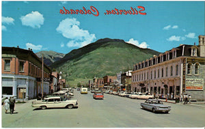 SILVERTON COLORADO MAIN STREET 1960'S LOTS OF CARS PARKED STORE FRONTS U.S CHROME POSTCARD