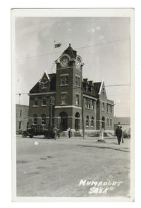 HUMBOLDT, SK. RPPC POSTCARD. POST OFFICE WITH CLOCK TOWER  BUILT 1911. CANADA